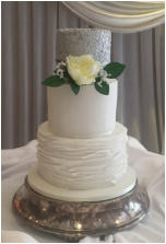 WIlver and White Wedding Cake